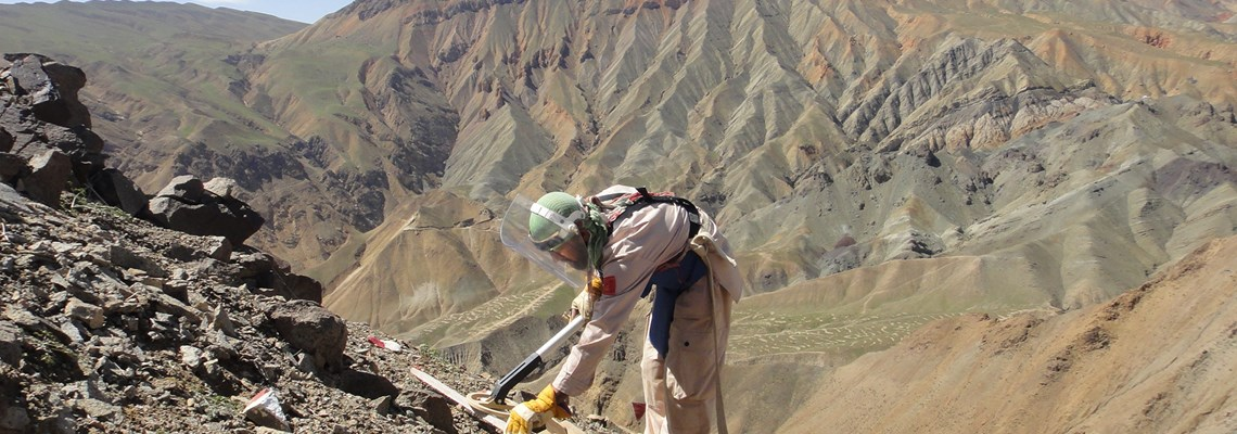 A deminer on mountainside in Afghanistan, HALO Trust