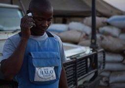 Male deminer from Mozambique on phone, HALO Trust