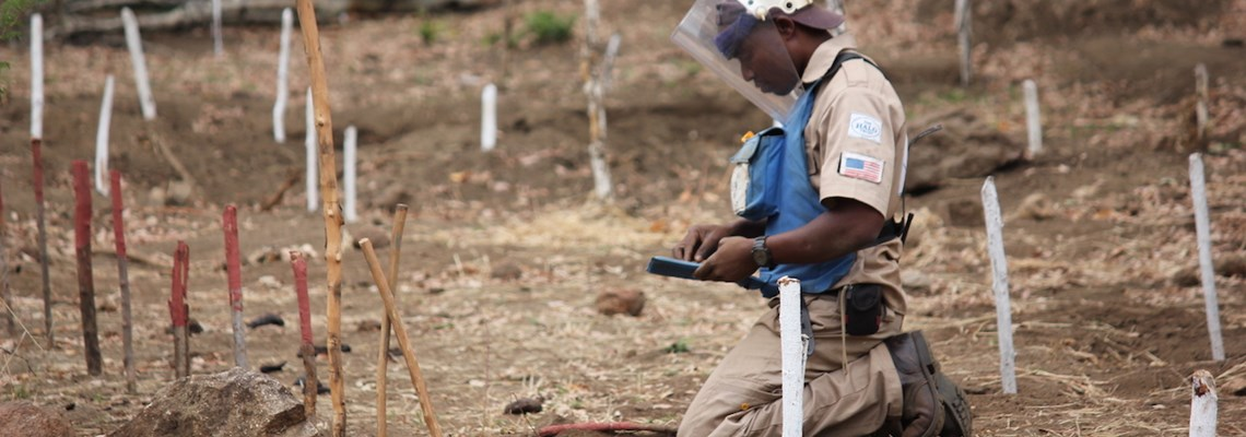 A HALO deminer working in a minefield in Mozambique