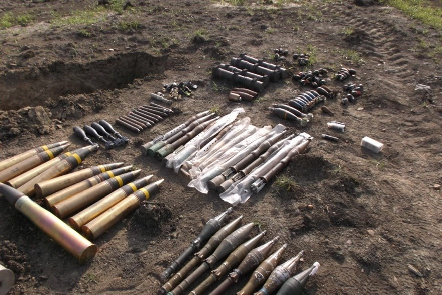Various types of ammunition adjacent to the demolition 'pit', into which they will be arranged to give optimum effect during the demolition, HALO Trust.