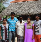 The Geevarasa family in front of their home in Sri Lanka, HALO Trust