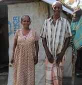 Mr Muthiya Nadason and his wife in front of their home, Sri Lanka, HALO Trust