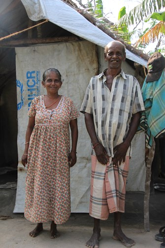 Mr Muthiya Nadason and his wife in front of their home
