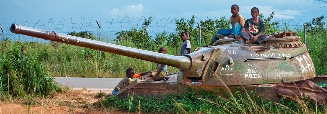 Angolan children play on tank, HALO Trust