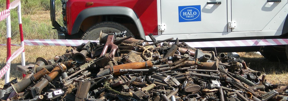 pile of weapons in Angola, HALO Trust.