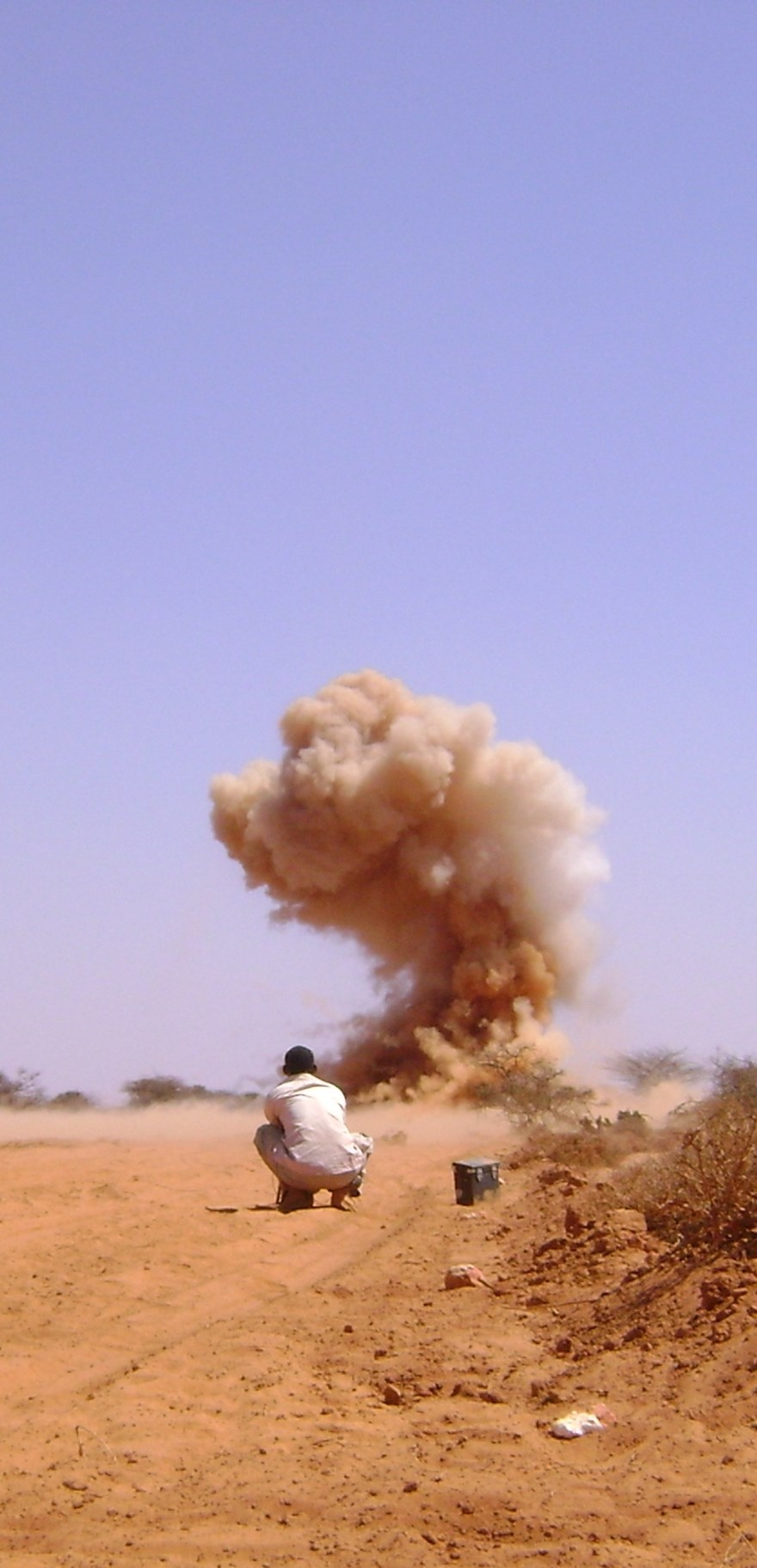 HALO supervisor Abdi Arab conducts a demolition during 2009 LIS resurvey