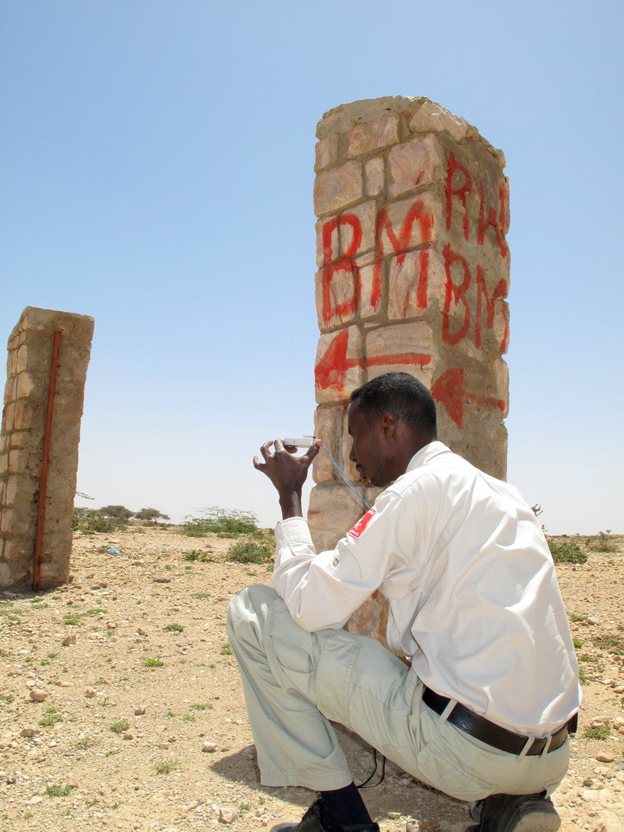 HALO Survey Supervisor Hasan Madobi takes a bearing