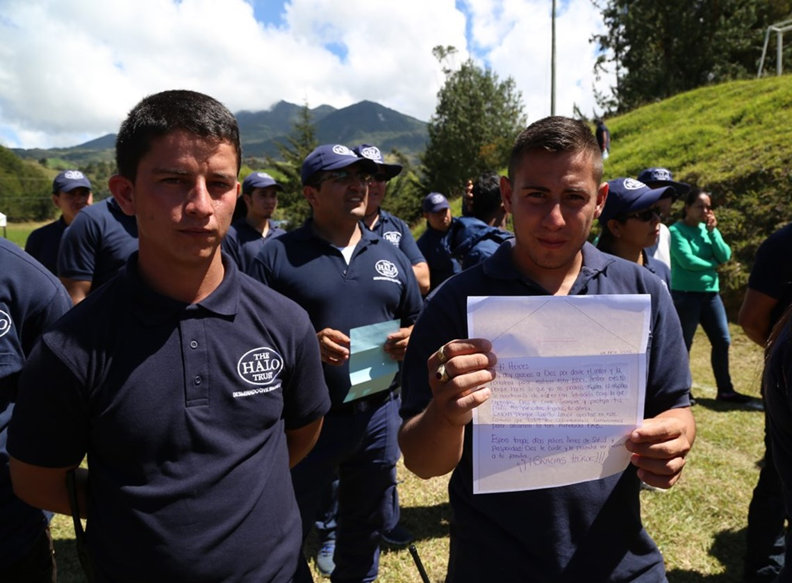 Colombian deminers with letters from our letter campaign, HALO Trust.