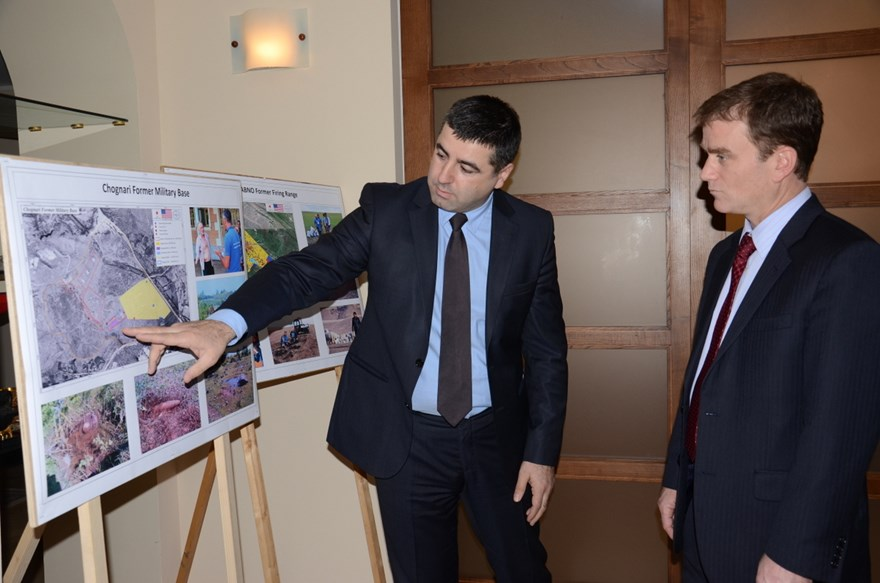 HALO Georgia programme manager, Irakli Chitanava shows the military base on the map to Nicholas Berliner Deputy Head of Mission US Embassy.