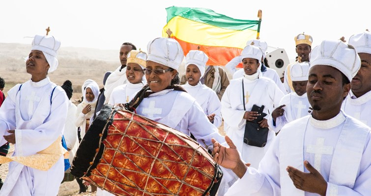 Pilgrims playing the drum during Epiphany at Qasr al-Yahud, HALO Trust