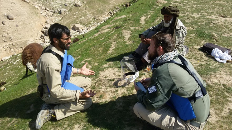 Abdul Hakim speaks with HALO staff on his family's grazing land in Marmul, Afghanistan
