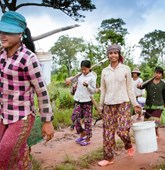 A foraging party of Doun Saur village Cambodia, residents prepares to leave HALO-cleared ground to gather wild potatoes in the forest - they earn 2 dollars per kilo