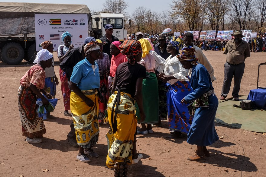 Local women perform a traditional dance at the handover ceremony.