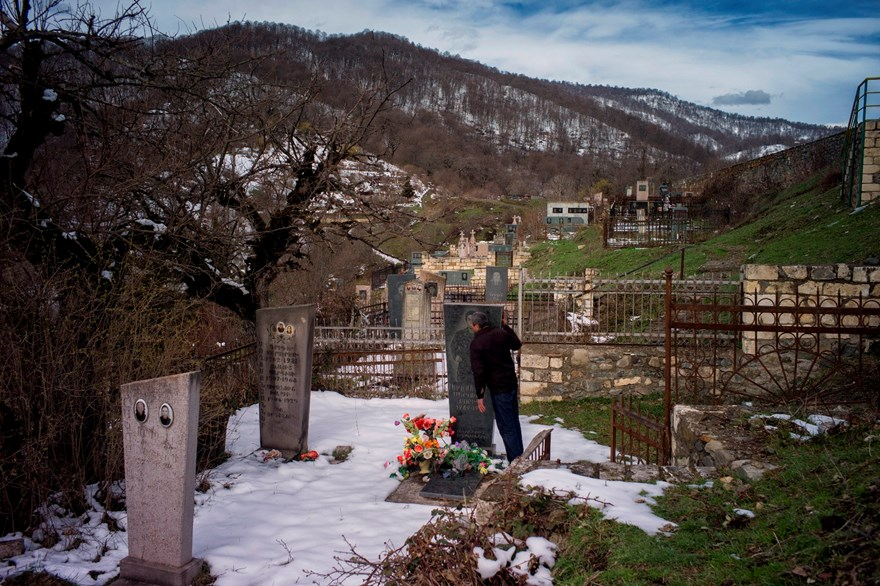 A man kisses his brother's gravestone in the cemetery beside Gandzasar monastery. The area around the monastery was cleared by HALO.