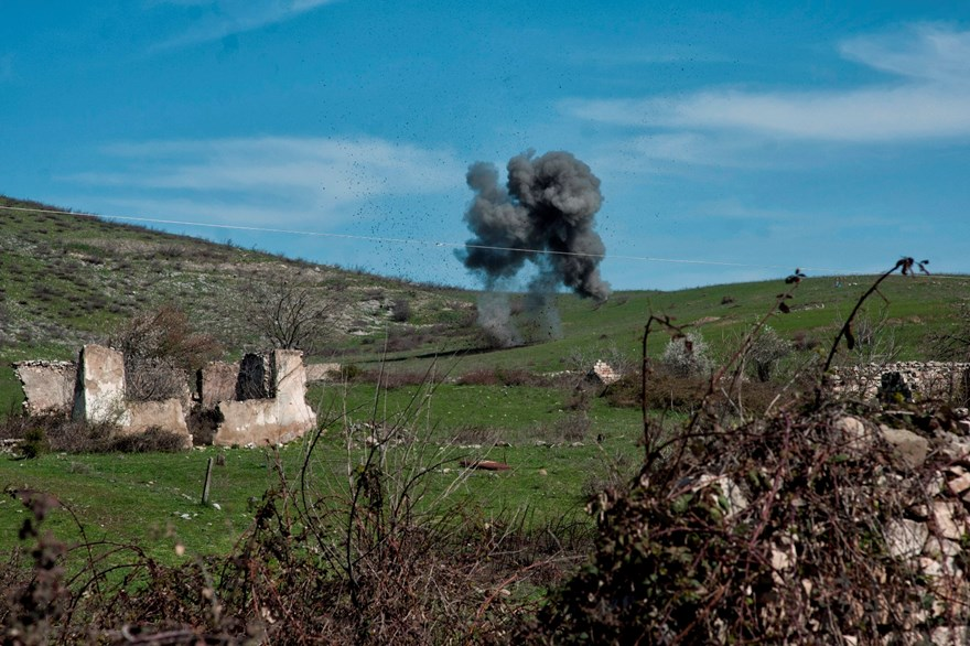 HALO deminers conduct a controlled explosion to destroy an anti-tank mine where it was found near Govshatly village.