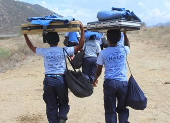 Deminers from HALO Angola's 100 Women in Demining team, heading out into the field with their kit.
