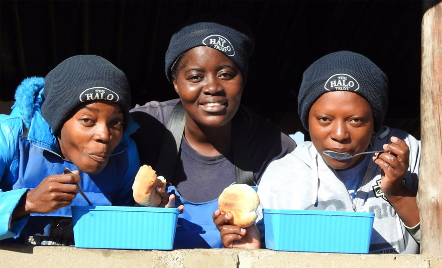 Lunch break for three of HALO Angola's 100 Women in Demining!
