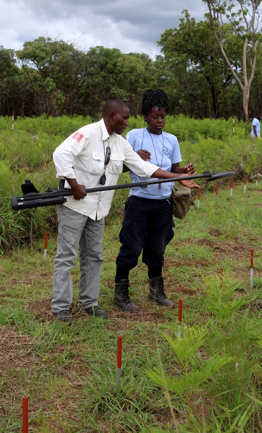 Deminer Rosa Cachiangui receives instruction from HALO Angola's Training Officer.