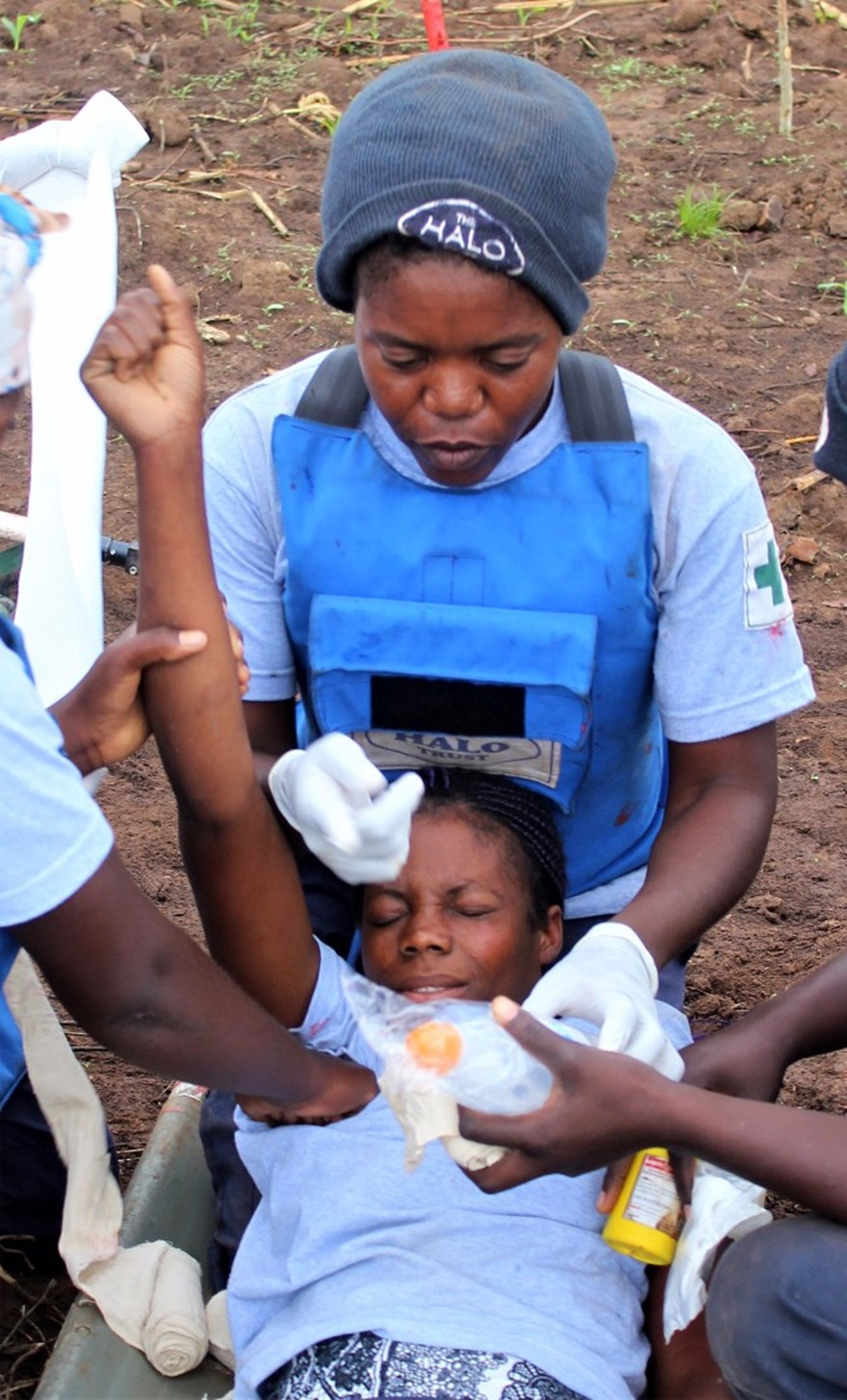 Elisa is one of HALO Angola's paramedic trained deminers. Here they practice emergency drills.