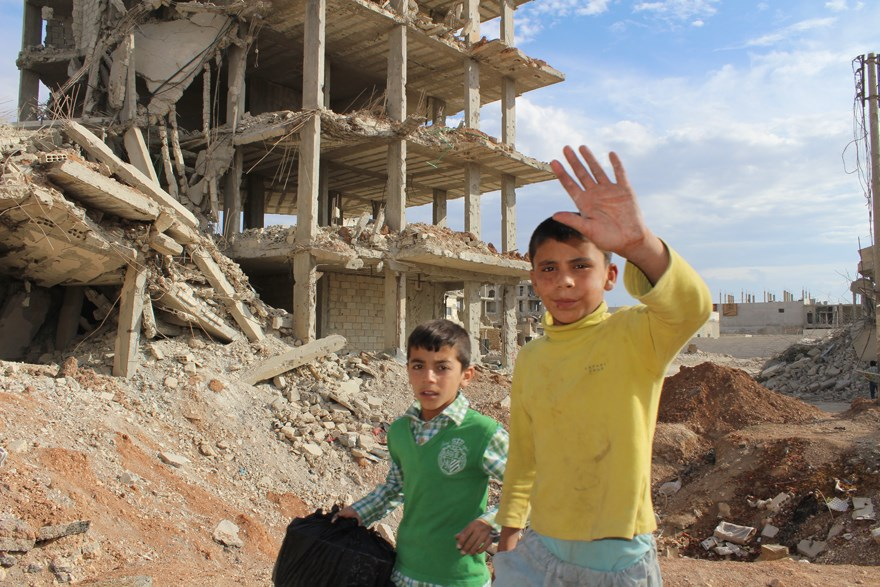 Two young boys in Kobane, which was heavily contaminated with IEDs and explosives.