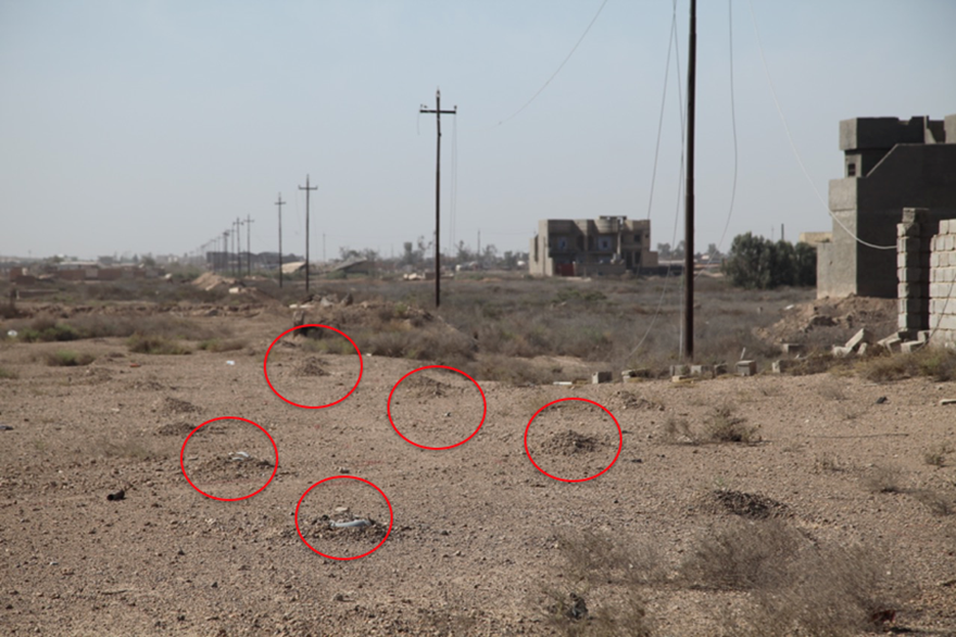 Rows of IEDs planted as barrier mines, Falluja, Iraq.