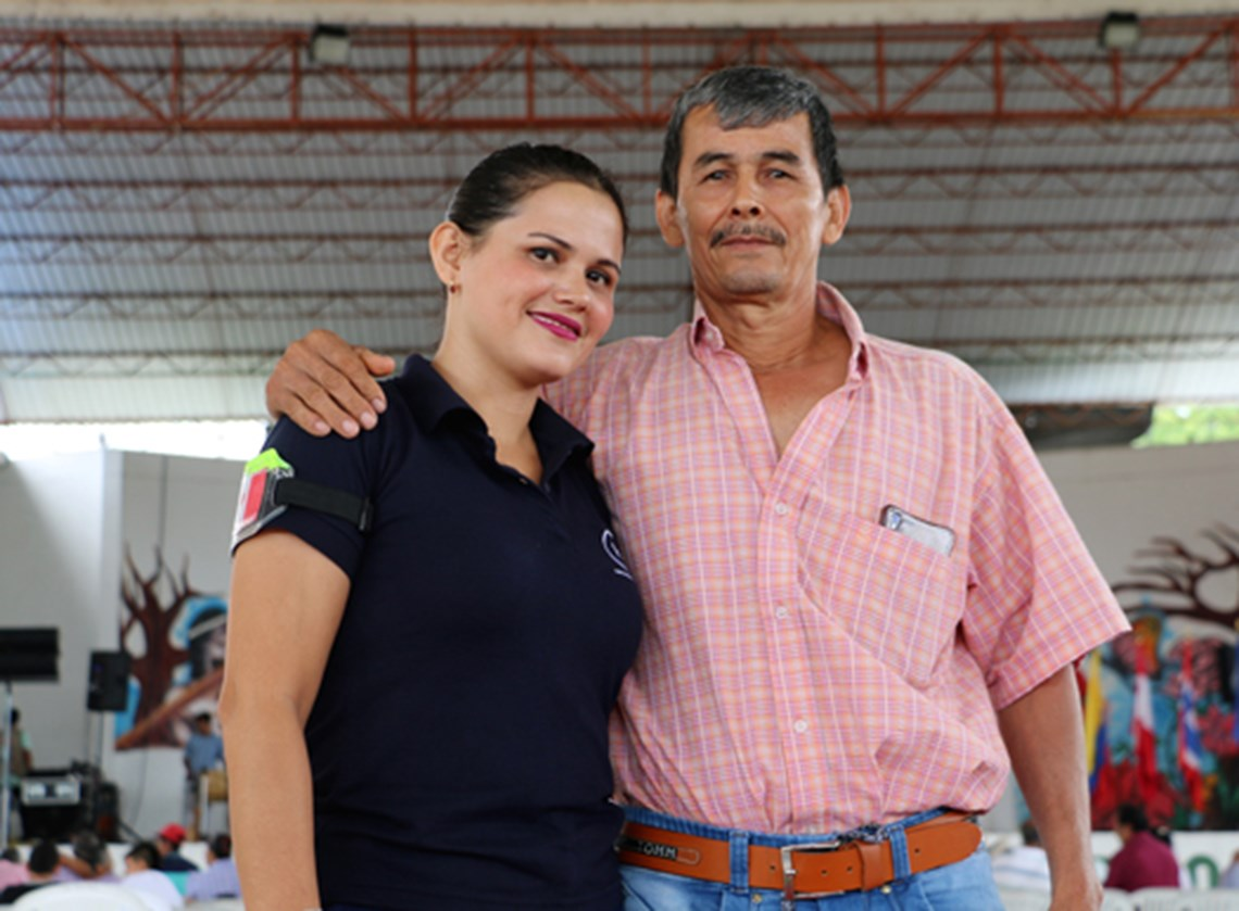 HALO's Handover Officer in Tolima, Claudia Morales, with her father Arcardio who is very proud of her work.