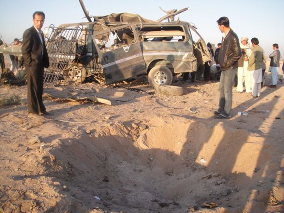 A minibus destroyed by an anti-vehicle mine