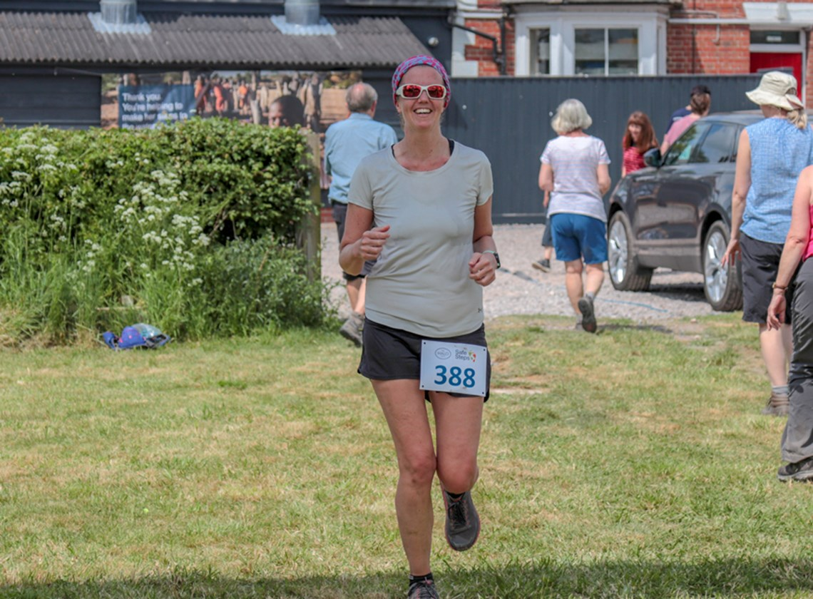 HALO's Jenny McIvor sprints across the finish in an incredible 4:06 hours